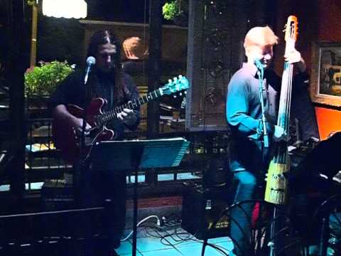 The Music Remembrance Guitar and Bass Jazz Duo performing Triste by Jobim live in Orlando, Florida. The Music Remembrance Jazz Duo is available for Or...