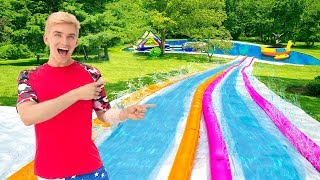 Worlds BIGGEST Inflatable Backyard Slip N Slide!! (Sharer Family Ultimate Surprise Party Reveal)