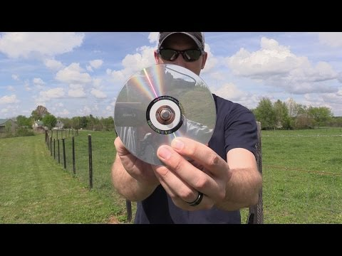 Shooting through the center of a CD with a .45 Colt.
