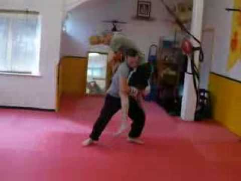 San Shou, basic boxing to take down drill. Coach Andy Willis, student Luke Kyriakides. Image 1