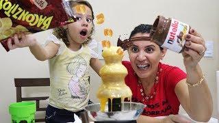 DESAFIO DA CASCATA DE LEITE CONDENSADO - COM NUTELLA CHEETOS BALAS  E FRUTAS