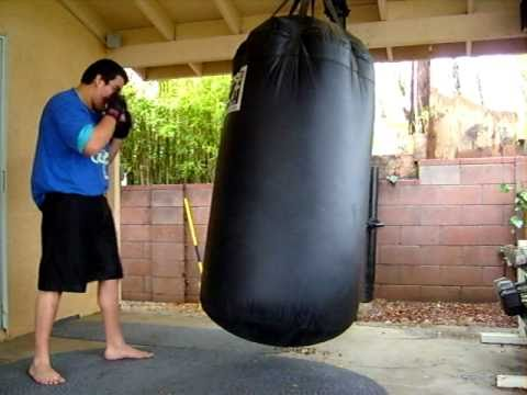 Bas Rutten Workout On 500 LB Punching Bag.
