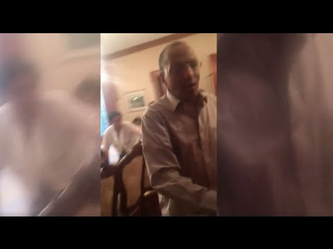 Ambassador Girma Biru Attacking Young Oromo Ethiopians