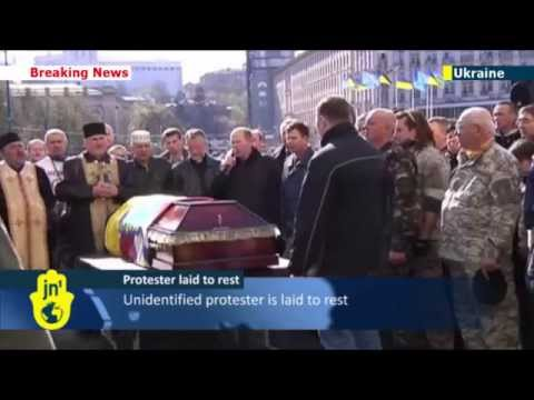 Ukraine Mourns and Rebuilds: Residents of Kiev bury remains of unknown protester and begin clean-up