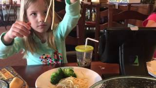 Kids eating Pasta noodles at the Olive Garden