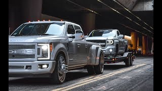 Twin Turbo GMC On 30's Being Towed By F350 On 26's