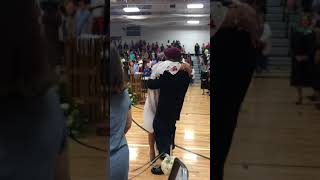 Returning Soldier Surprises Little Sister at Graduation