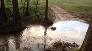 Traxxas E-Maxx vs Traxxas Summit in the river and mud