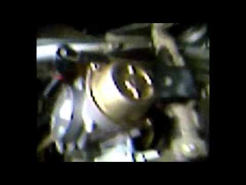 how to change the spark plug on a Polaris predator 500
