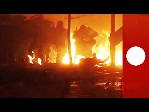 War zone in Kiev: Violence rages as protesters throw petrol bombs at police