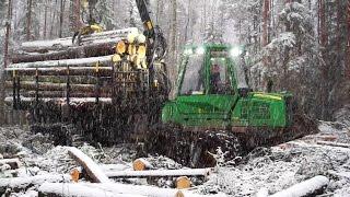 Fully loaded John Deere 1110E in wet snowy winter forest conditions
