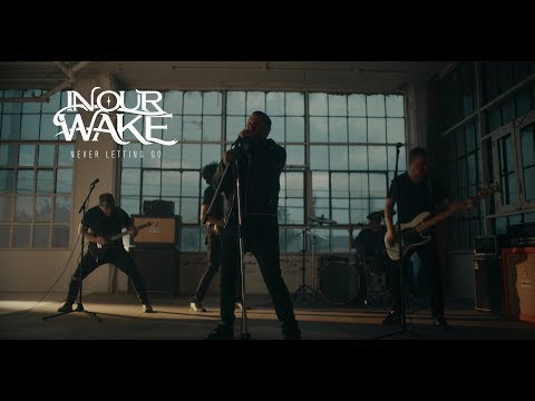 In Our Wake - Never Letting Go (OFFICIAL MUSIC VIDEO)
