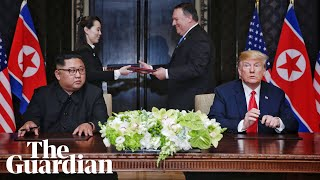 Kim and Trump sign joint agreement at close of Singapore summit