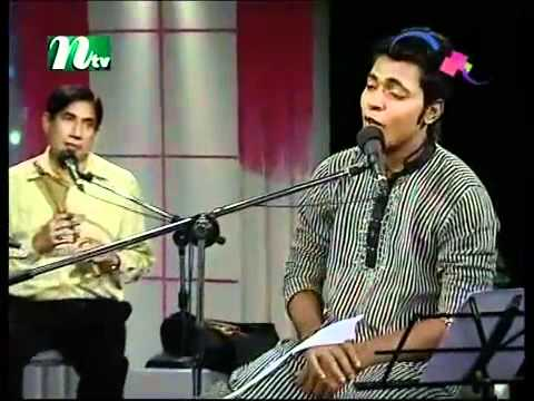 Nice Bangla Song-amar Buker Modhey Khane By Nancy Arfin Rumi.(shakil) video
