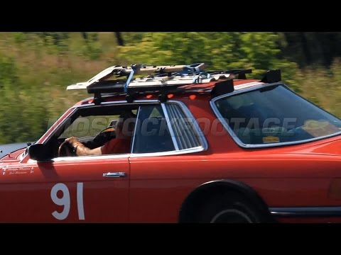 Red sport-looking vintage car Mercedes 450 SLC in international racing. Stock Footage
