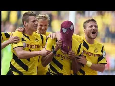 Borussia Dortmund forward Pierre-Emerick Aubameyang pulls on Spiderman mask..