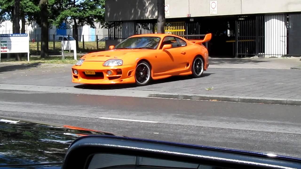 Orange Toyota Supra Driving Out Garage