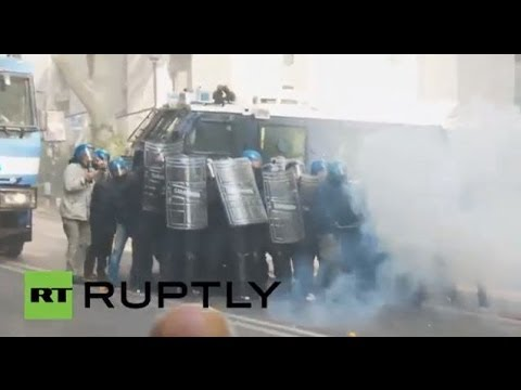 Italy: Police get egged by anti-austerity protesters