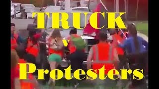 Truck Pushes Protesters Out Of The Way