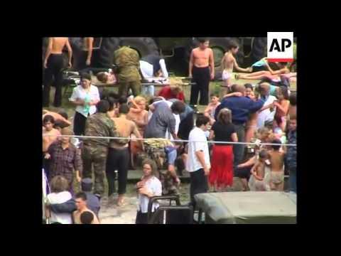Fighting at siege school; children reunited with parents; injured
