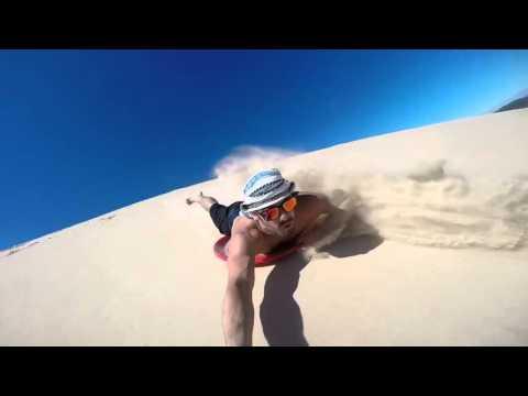 Friends Slide Down Sand Dunes