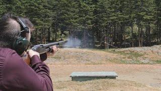 An attempt at trap shooting (12 ga shotgun on clays)