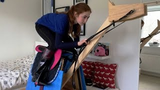 Girl Practices Riding On Wooden Horse