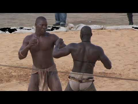 Senegalese wrestling...this rather bad video I made 5 years ago...Please check this 2014 trailer: http://www.cinecrowd.nl/la-lutte-sneeuw-en-zand?language=en...