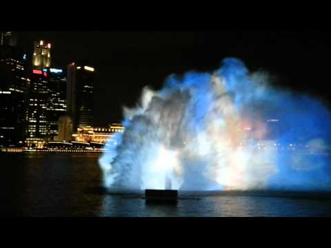 Laser effects light water show Singapore at marina bay sands skypark hotel by big shopping center
