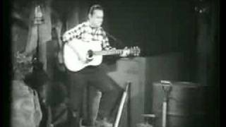 Watch Merle Travis Sixteen Tons video