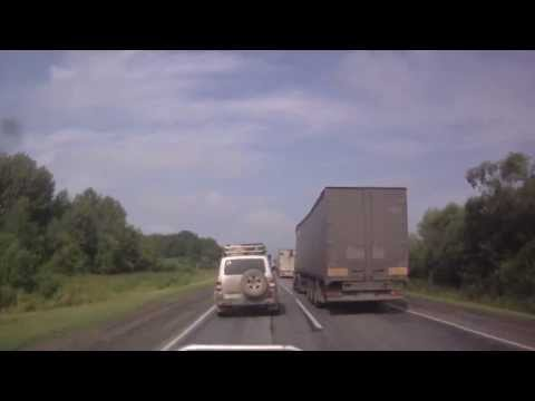 Car Crashes into Truck