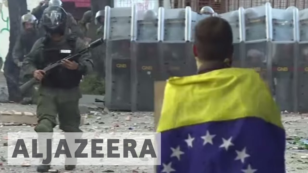 Two killed as Venezuela strike erupts into violence