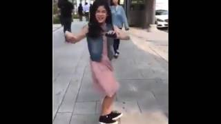 Asian girl dancing on a song