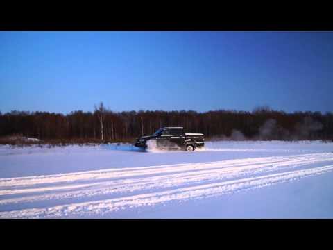 УАЗ Патриот Пикап по заснеженному полю