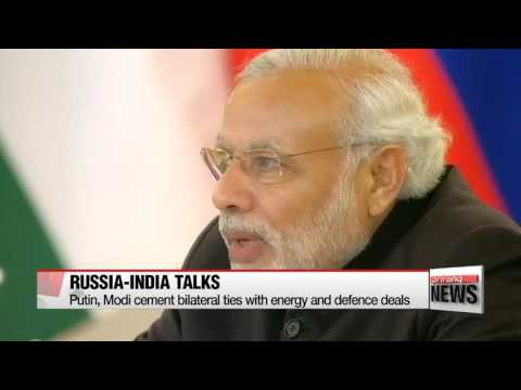 Russia, India ink energy and defense deals