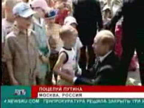 Putin kisses a boy on stomach