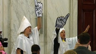 Protesters in KKK garb removed from Sessions
