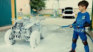 Funny Den ride on Quad BIKE to CAR WASH and washing power wheels from mud. Pretend play for kids