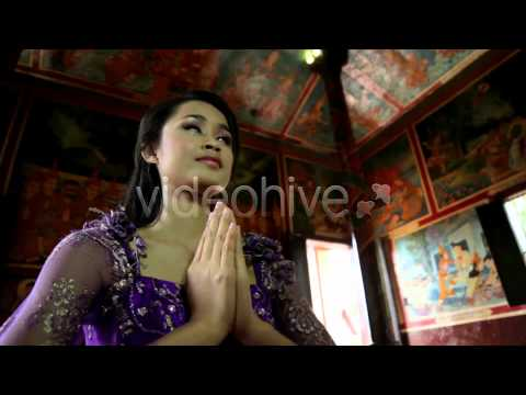 Stock Footage - Asian Girl Praying In Temple - Cambodia 9 | VideoHive