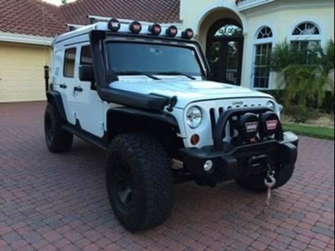 SOLD - 2013 Jeep Wrangler Unlimited Rubicon Extreme Camper for sale by Autohaus of Naples