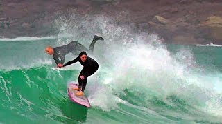 Surfing at Sennen Cove in Cornwall UK