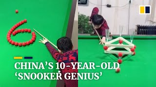 Chinese boy becomes online star for his snooker trick shots