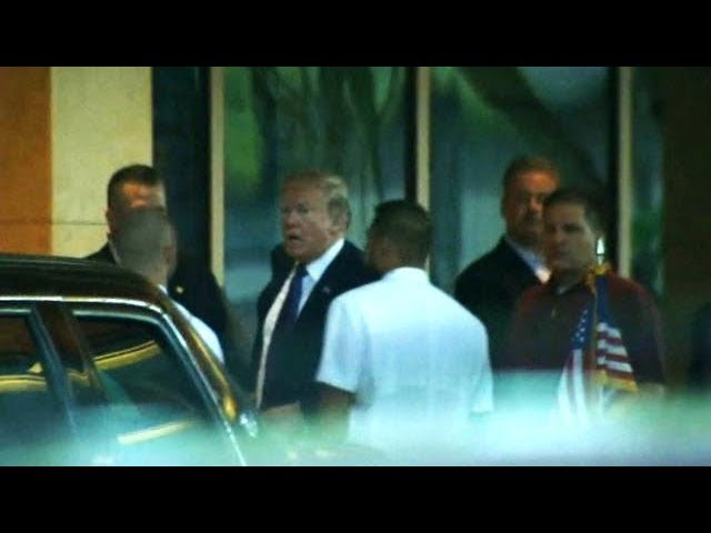 Trump makes unexpected stop before Asia trip