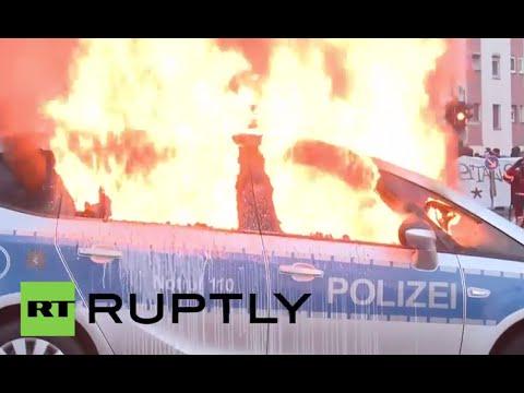 Germany: Militants set police car AFLAME in ECB protest