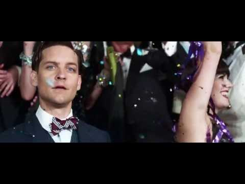 http://thegreatgatsbymovie.com/ http://www.facebook.com/thegreatgatsbymovie The Great Gatsby directed by Baz Luhrmann and starring Leonardo DiCaprio. Now playing!  The Great Gatsby follows Fitzgerald-like, would-be writer Nick Carraway (Tobey Maguire) as he leaves the Midwest and comes to New York City in the spring of 1922, an era of loosening morals, glittering jazz and bootleg kings.  Chasing his own American Dream, Nick lands next door to a mysterious, party-giving millionaire, Jay Gatsby (Leonardo DiCaprio) and across the bay from his cousin, Daisy (Carey Mulligan) and her philandering, blue-blooded husband, Tom Buchanan (Joel Edgerton).  It is thus that Nick is drawn into the captivating world of the super rich, their illusions, loves and deceits.  As Nick bears witness, within and without the world he inhabits, he pens a tale of impossible love, incorruptible dreams and high-octane tragedy, and holds a mirror to our own modern times and struggles.