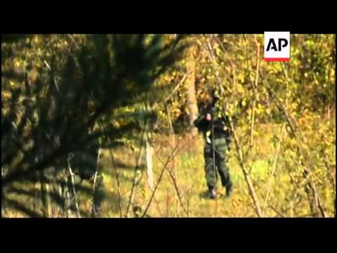 Police search remote village after US Embassy shooting