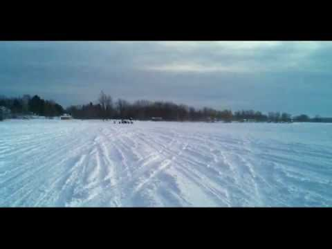 Arctic Cat XF 1100 Turbo vs. a Ski Doo 800 MXZ X E-Tec Snowmobile DRAG RACE