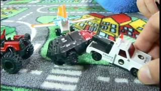 Toy cars being towed by police on carpet with roads
