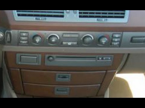 How to Remove Radio / CD Player from 2006 BMW 750i for Repair.