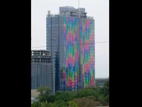 Gulliver skyscraper all colors of the rainbow. Небоскрёб Гулливер (Gulliver) светится днём.